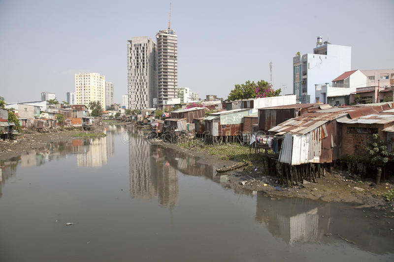 Slumm at Saigon river channel. Water of Saigon river in Ho Chi Minh city in Vietnam are heavily polluted and are source of disease for the poor people who live royalty free stock photo