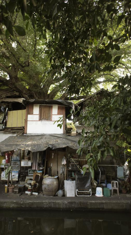 Slums house poor ramshakle of Southeast Asia along the Klong. Thailand, Bangkok photo. Slums house poor ramshakle of Southeast Asia along the Klong River royalty free stock images