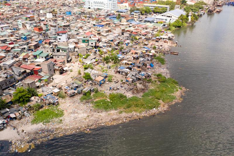 Slums in Manila, a top view. Sea pollution by household waste. Plastic trash on the beach stock photography