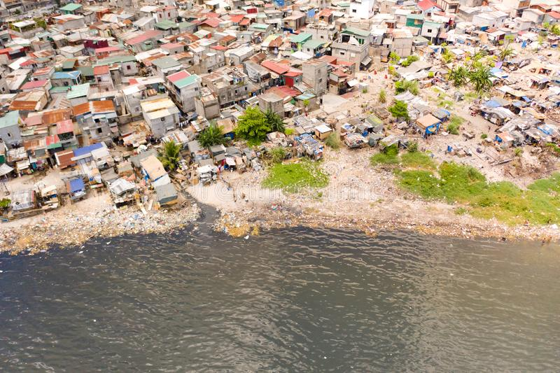 Slums in Manila, a top view. Sea pollution by household waste. Plastic trash on the beach stock photos