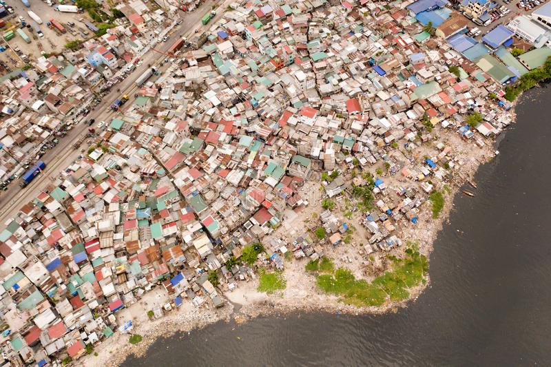 Slums in Manila, a top view. Sea pollution by household waste. Plastic trash on the beach royalty free stock photos