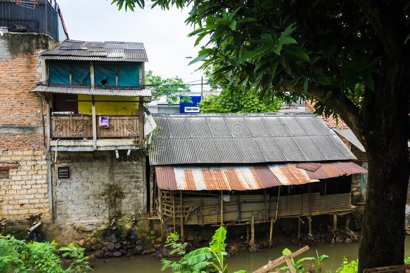 Slums near dirty river with rooftop made from zinc photo taken in Depok Indonesia. Java royalty free stock photo