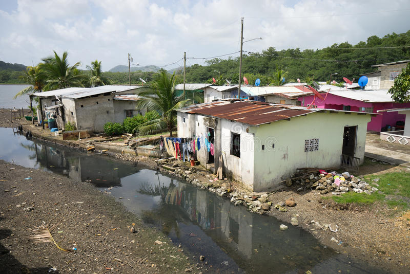Slums in Portobelo Panama by the sea. June 12, 2016 Portobelo, Panama: slums next to the tourist attraction of Fort Jeronimo royalty free stock photos