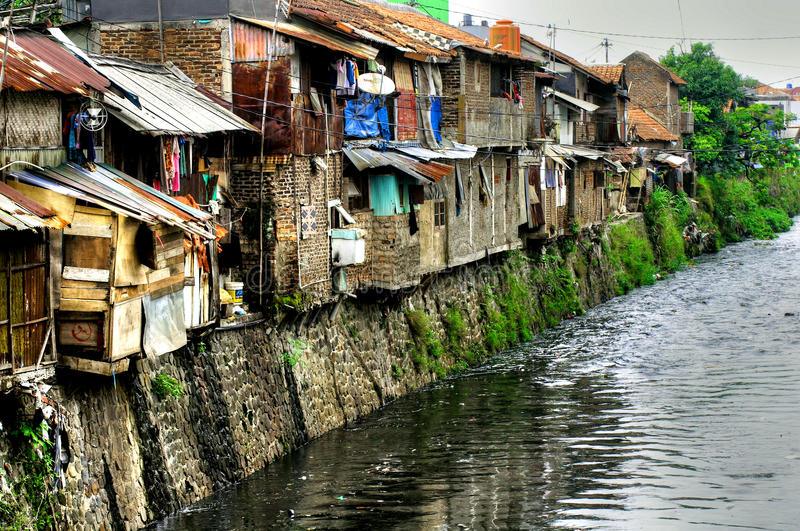Slums on river, Indonesia stock images