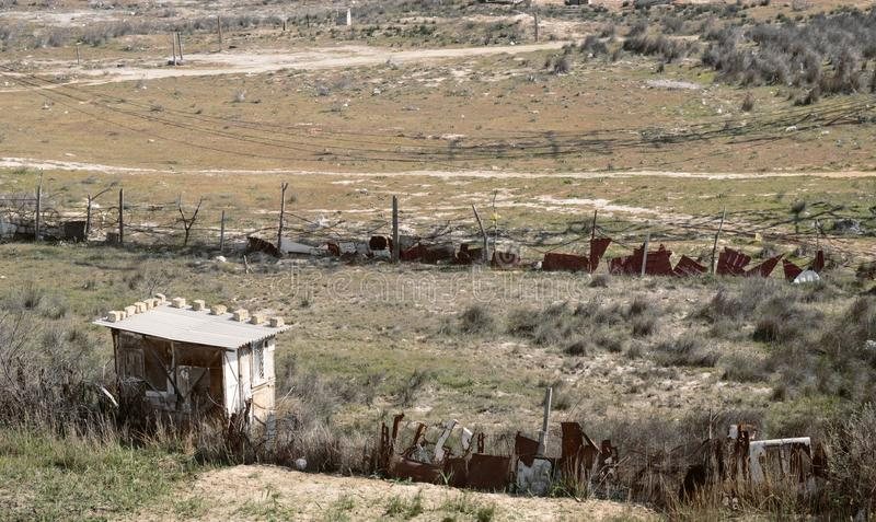 Slums in the steppe. Buildings made of rusty sheets stock photo
