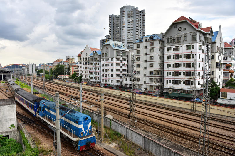 Slums and train. A train is passing through the slums in Shenzhen, China stock photo