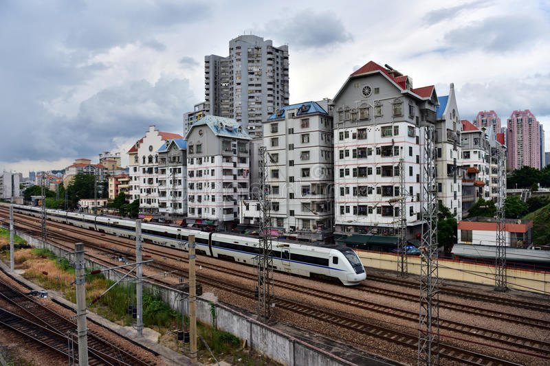 Slums and train. A train is passing through the slums in Shenzhen, China royalty free stock photos