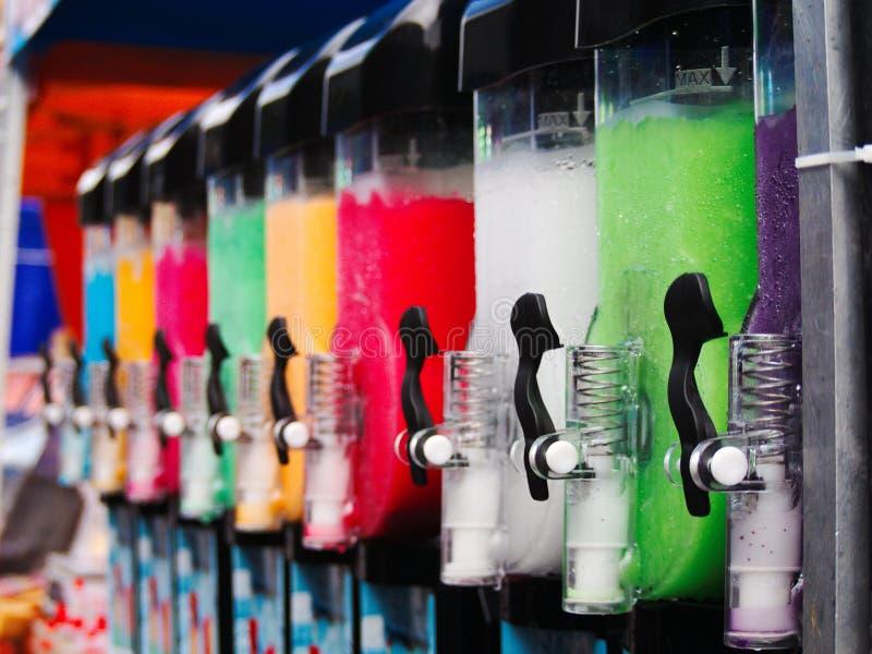 Slushy machines. Colourful slushy machines in row stock photo