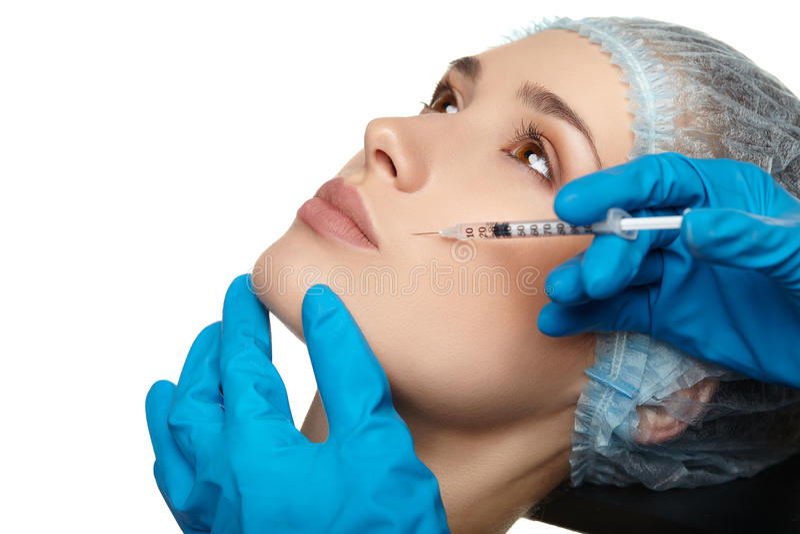 Slut för kirurgi för skönhetkvinnaframsida upp ståenden arkivbilder
