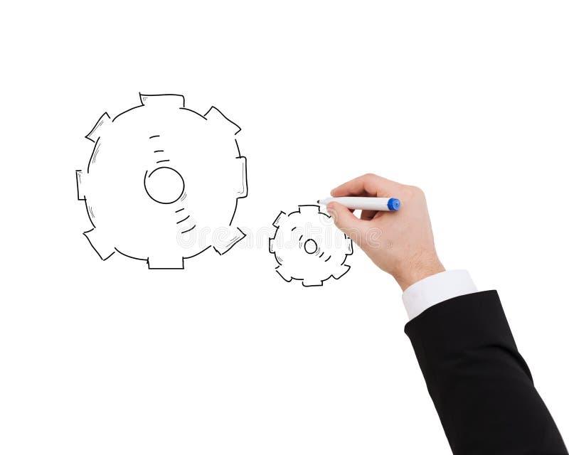 Slut upp av affärsmanteckningskugghjulet arkivfoton
