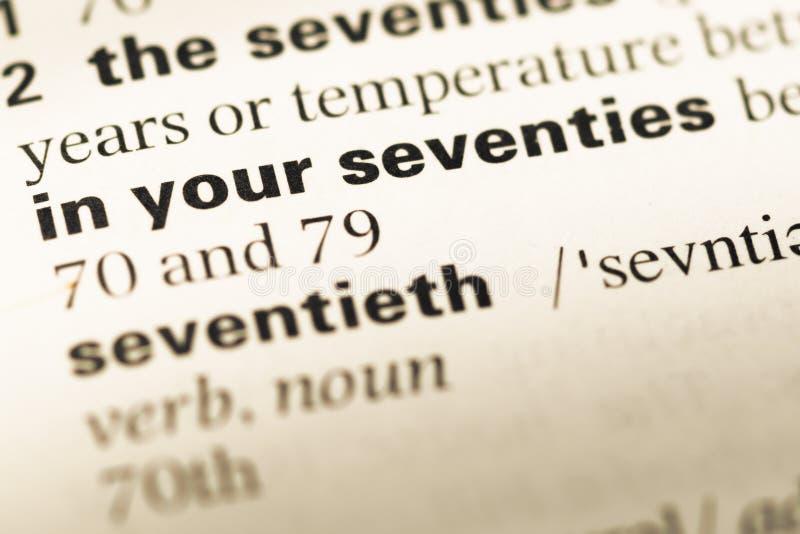 Slut upp av den gamla engelska ordboksidan med ord i dina seventies arkivbilder
