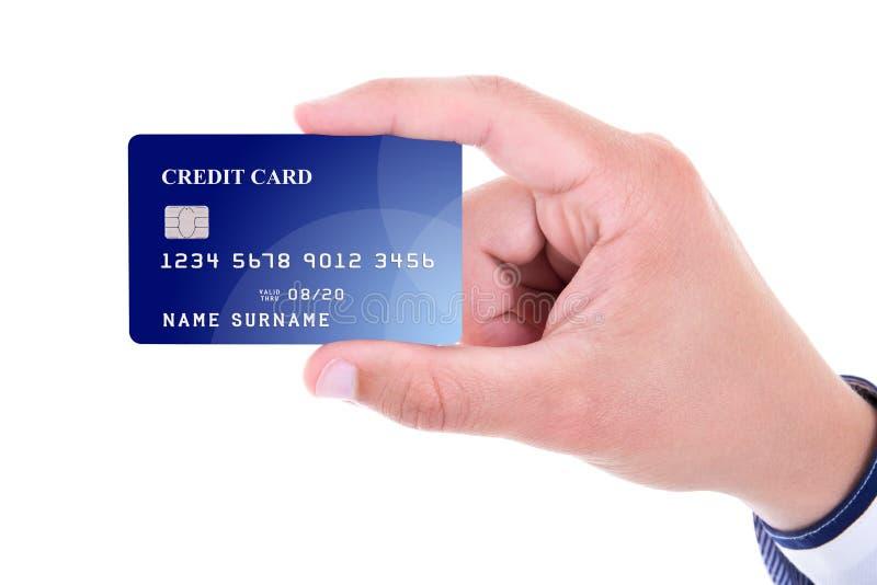 Slut upp av den hållande plast- kreditkorten för manlig hand som isoleras på wh royaltyfri foto