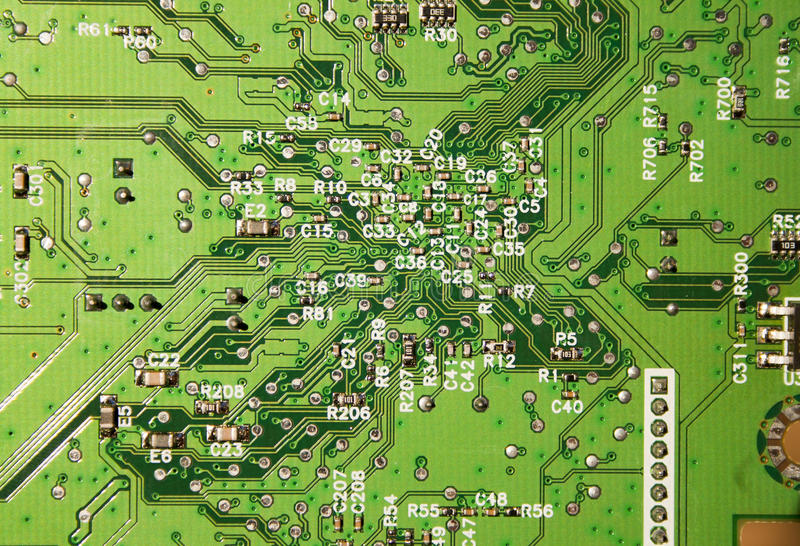 Slut upp av elektroniska strömkretsar i teknologi royaltyfri foto