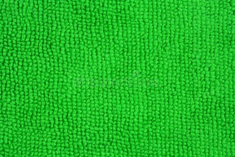 Slut upp av en grön microfibertorkduk royaltyfri fotografi