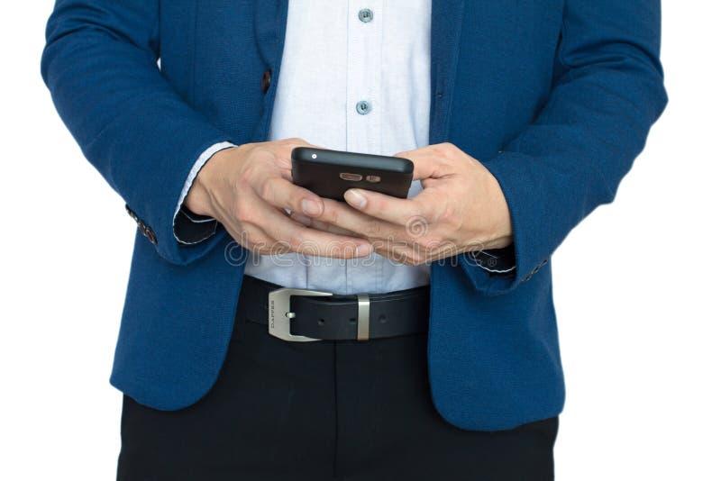 Slut upp av händer med den smarta telefonen arkivfoto