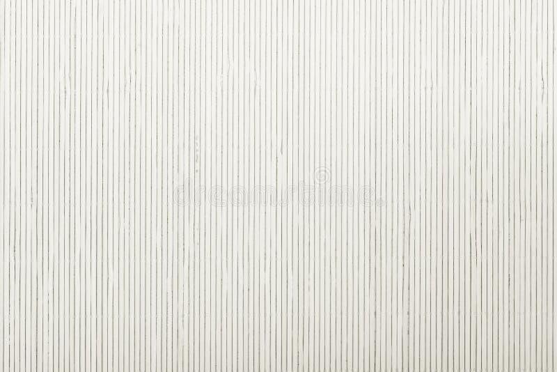 Slut upp för bakgrundstextur för vit bambu matt randig modell royaltyfri fotografi