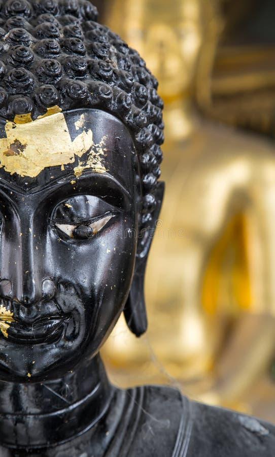 Slut upp halv framsida av en svarta buddha arkivfoton