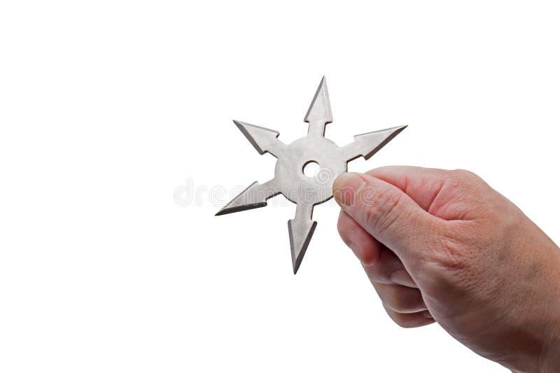 Slut upp handinnehavet Ninja Star Shuriken Isolated på vit bakgrund med urklippbanan och kopieringsutrymme royaltyfri bild