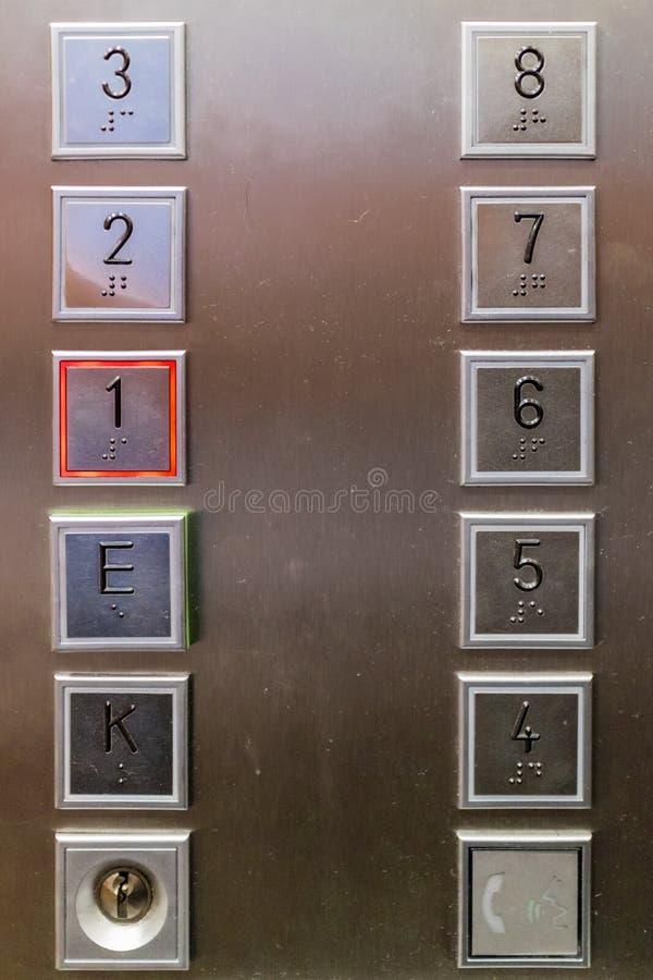 Slut upp på hissknappar fotografering för bildbyråer