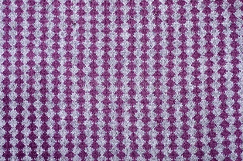 Slut upp på vertikal textur för woolen tyg för rät maska arkivbild
