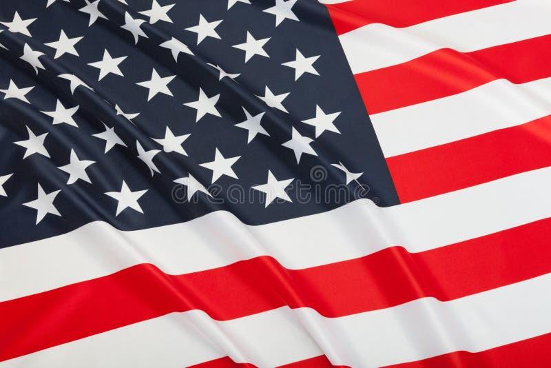Slut upp studioskottet av rufsade flaggor - Amerikas förenta stater arkivbilder