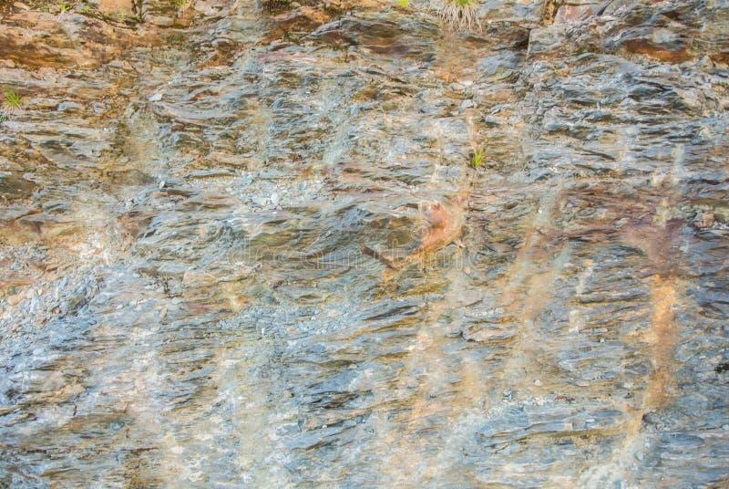Slutet av detaljer av den abstrakta naturliga stenen vaggar upp snitttextur c arkivfoto