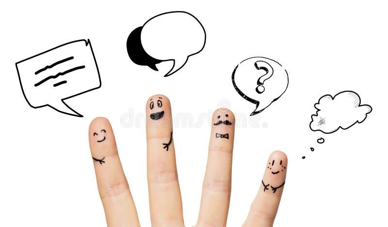 Slutet av fyra fingrar med smiley vänder mot upp arkivbild