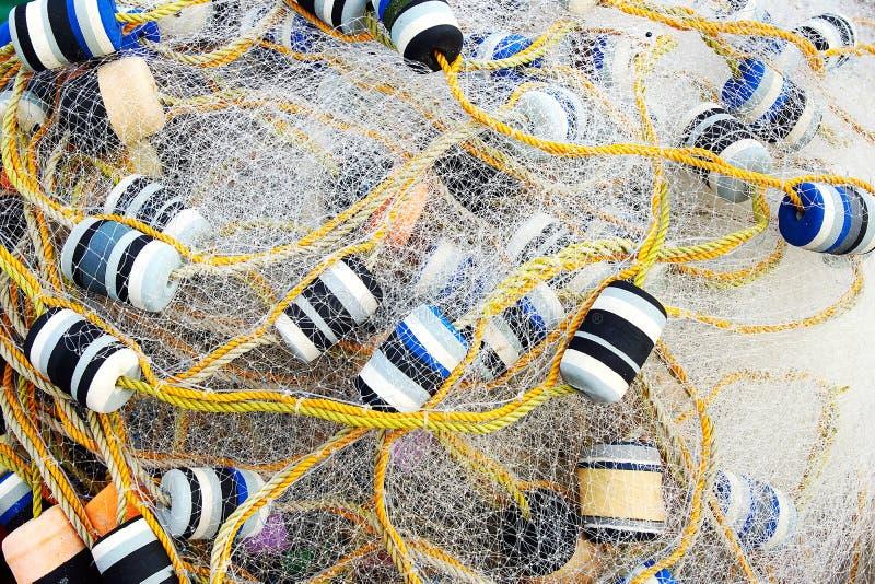 Slutet beskådar upp av fisknät. arkivbilder