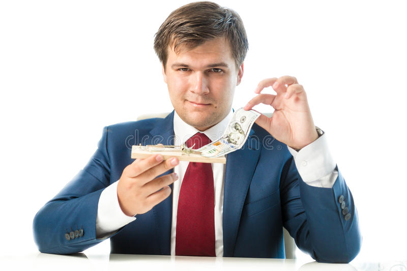 Sluwe zakenman die dollarrekening nemen uit muizeval stock foto