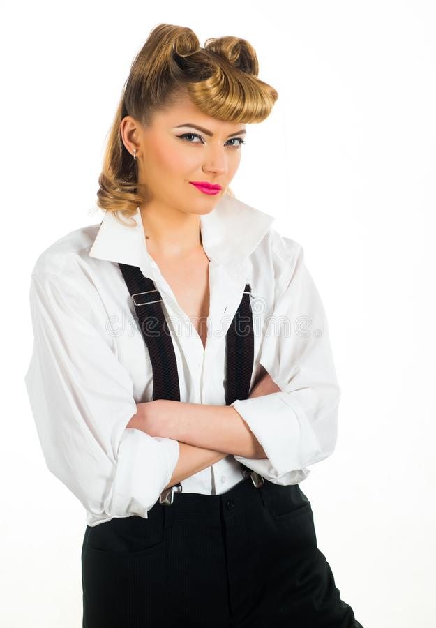 Sly woman. Cunning. The smirk A woman smiles with a secret thought. Mistrust. Young girl in business clothes. Startup stock images