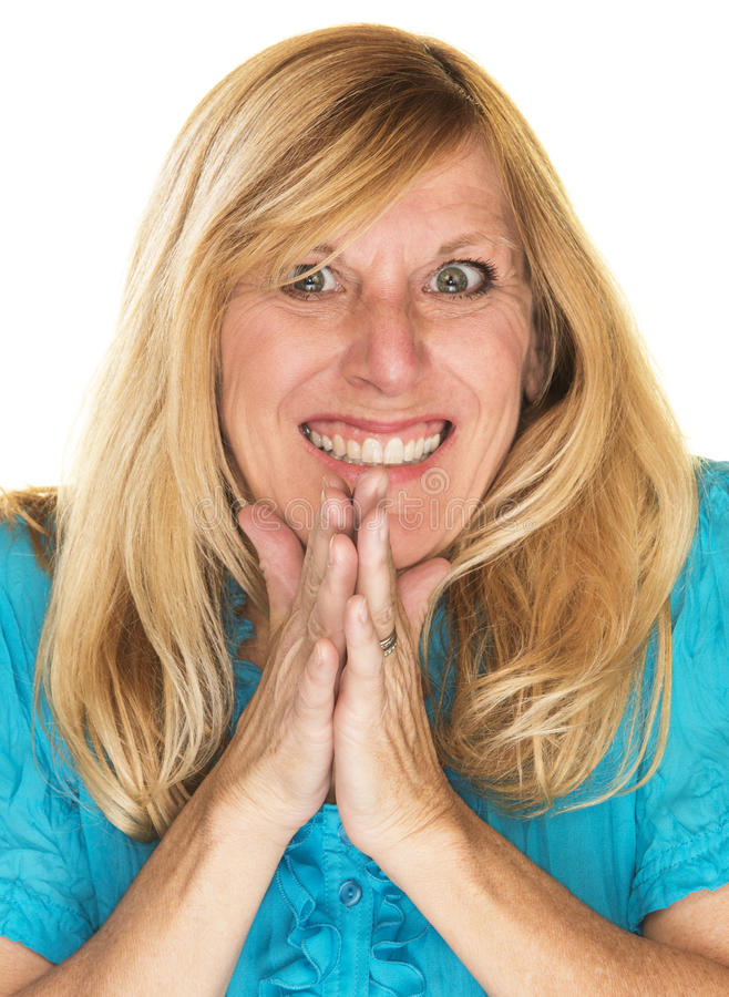 Sly Woman Rubbing Hands. Grinning mature female plotting and rubbing hands together stock photography