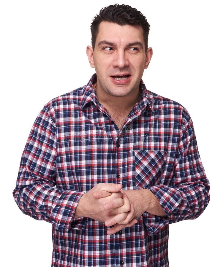 Sly young man in plaid shirt royalty free stock photography