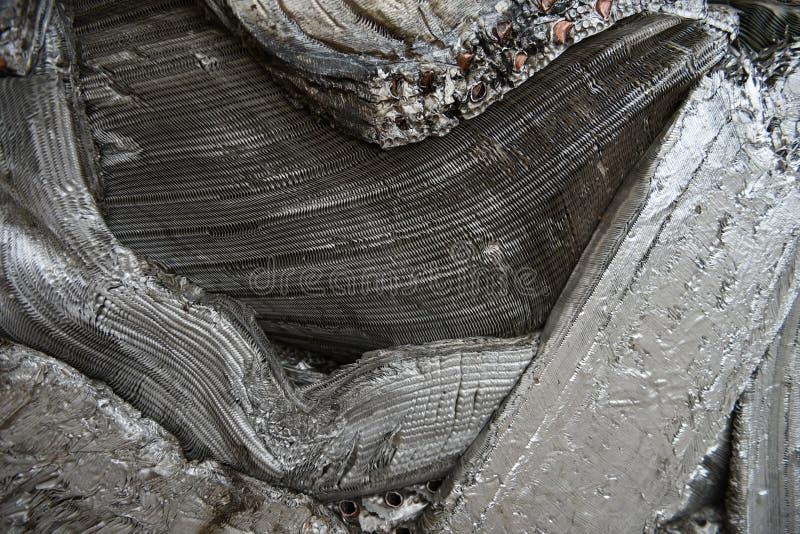 Smält, krossat, komprimerat metallskrot av aluminium arkivfoton