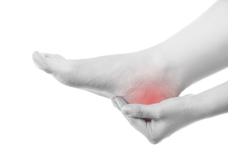 Smärta i den kvinnliga foten arkivbild
