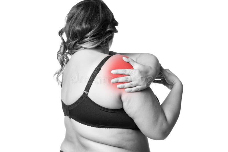 Smärta i skuldran, omsorg av kvinnlighänder, knip i kropp för kvinna` s arkivbilder