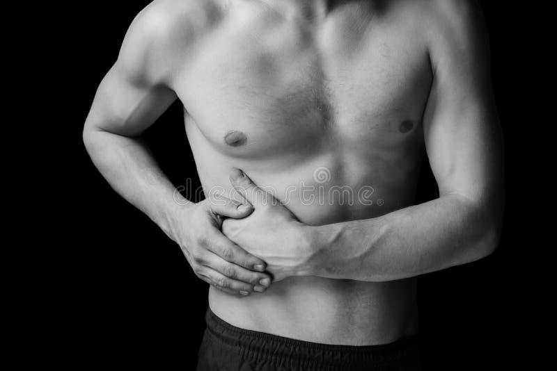 Smärta på rätsidan av magen royaltyfri bild