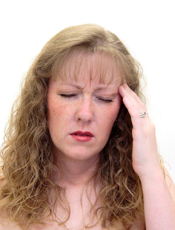 smärtsam kvinna för huvudvärk arkivbild