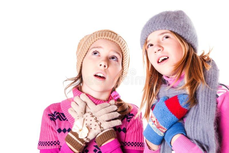 Små flickor lurar förvånat royaltyfria bilder