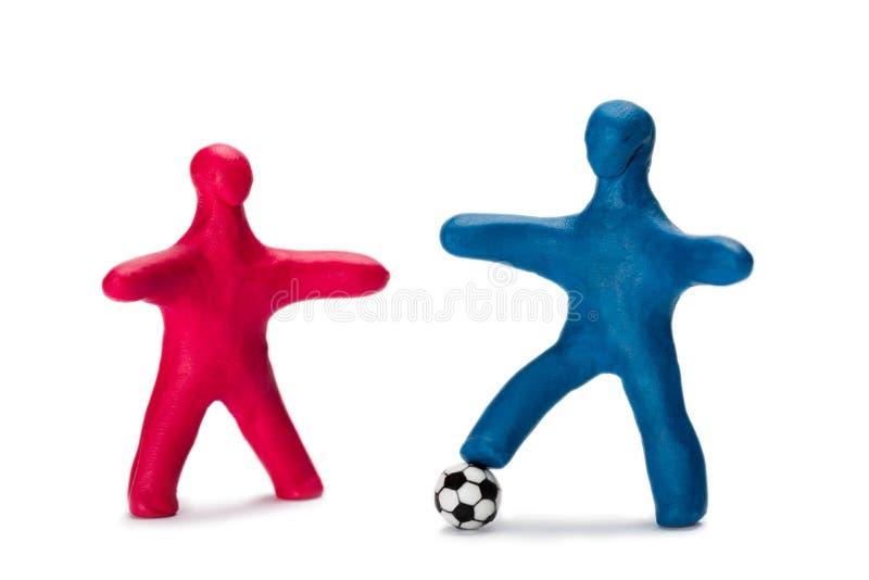 Små fotbollsspelare och bollspelare i plast royaltyfri foto
