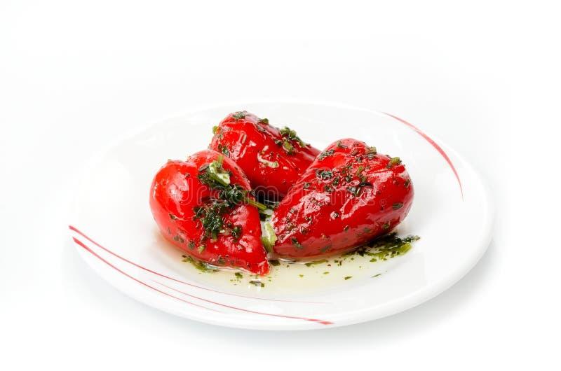 Små söta peppar som fylls med ost arkivbild