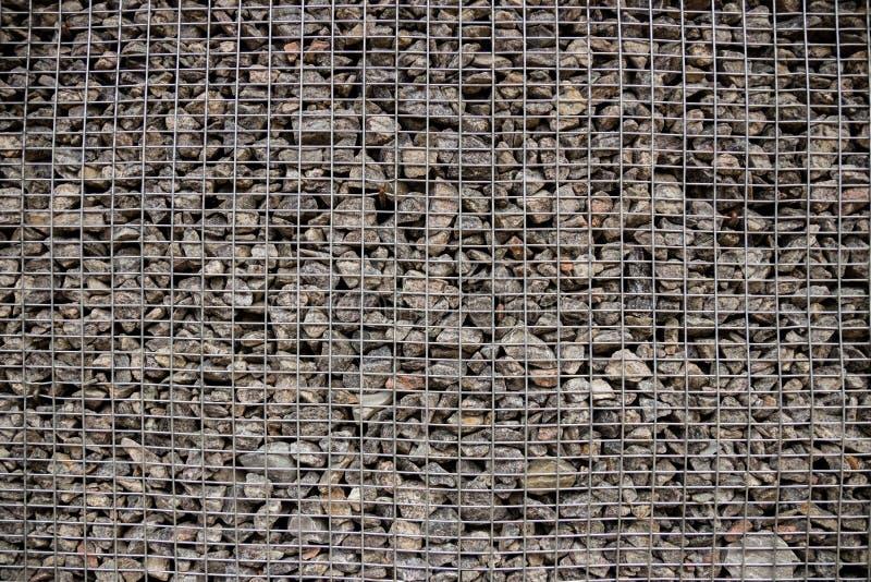 Små stenar under det netto arkivbild