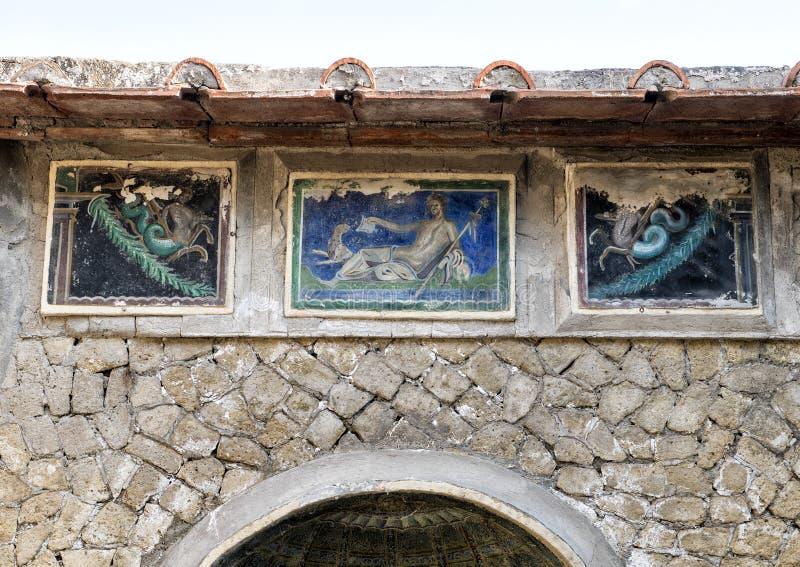 Små tegelplattamosaiker för Closeup, hus i Parco Archeologico di Ercolano arkivbild