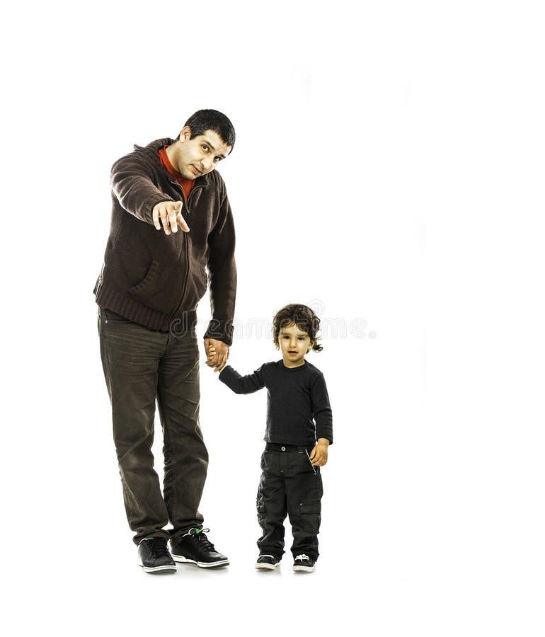 Småbarn och fader Pointing arkivbilder
