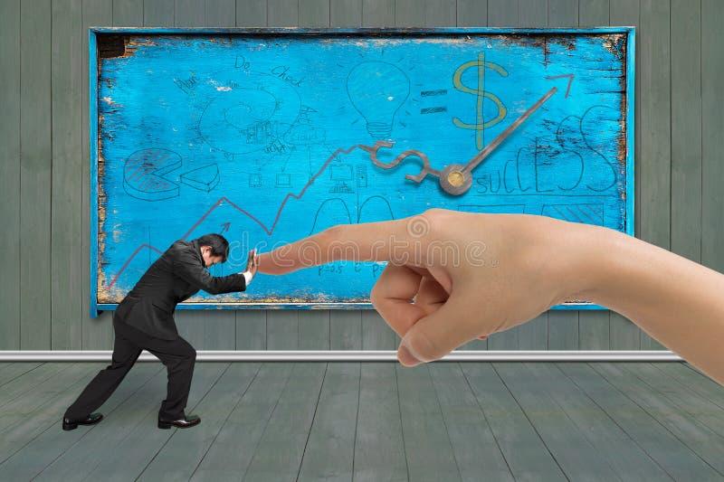 Småföretagare som skjuter mot pekfingret för stor hand royaltyfria foton