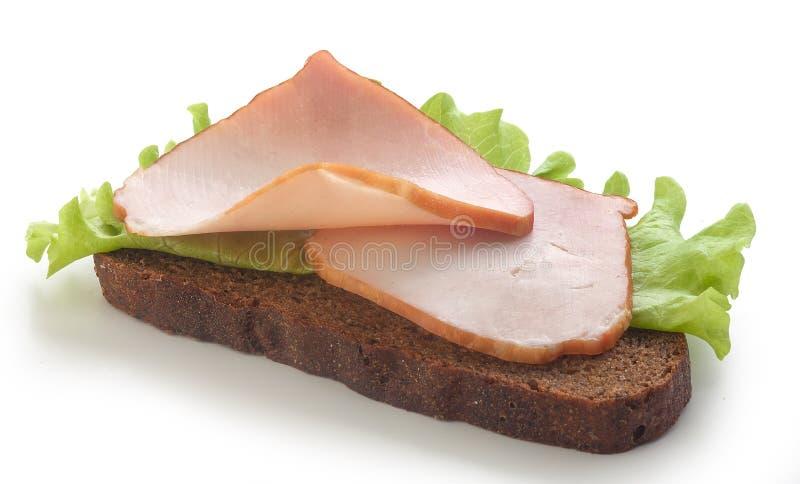 Smörgås med grisköttfläskkarrén arkivfoton