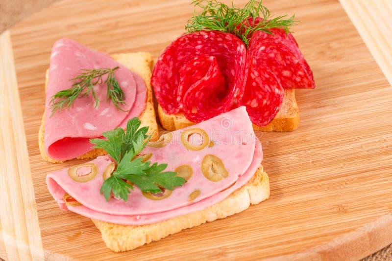 Smörgåsar med salami och mortadella royaltyfria foton