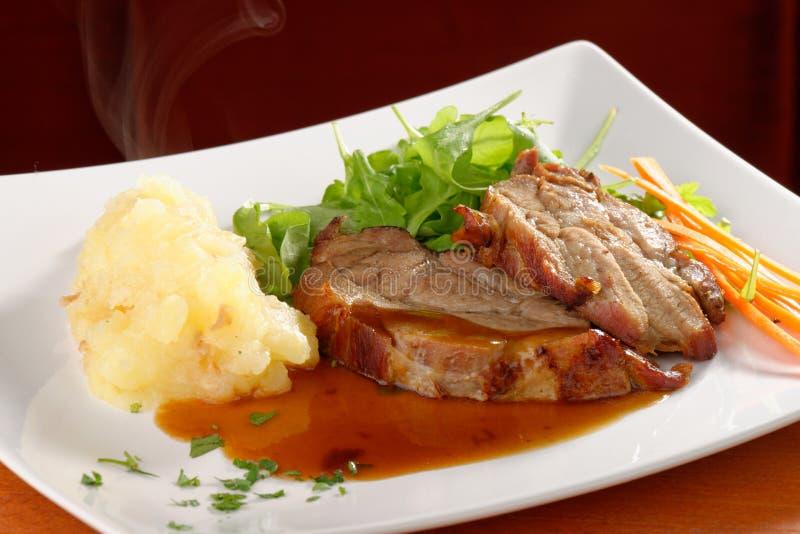 Smażący wieprzowina kotlecik, puree ziemniaczane obraz stock