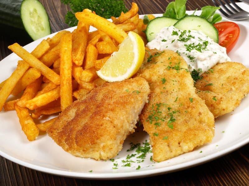 Sma??ca ryba z francuskimi d?oniakami fotografia royalty free