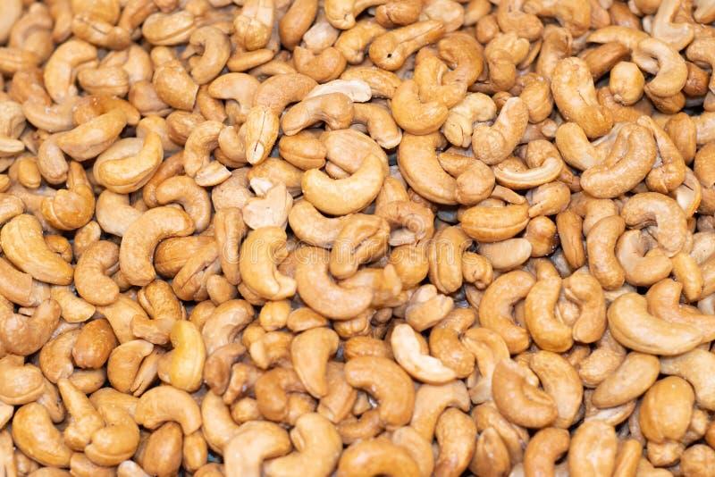 Smakelijke die cashewnoten als achtergrond worden gebraden stock foto