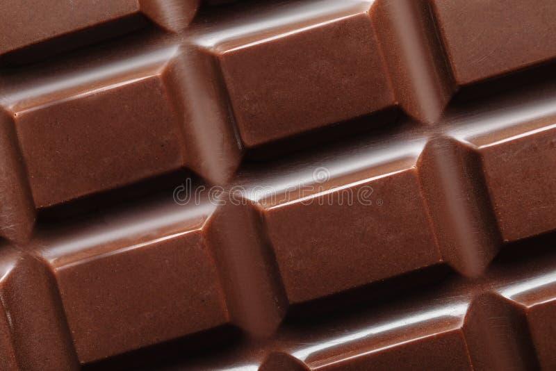Smakelijke donkere chocoladereep als achtergrond royalty-vrije stock afbeelding